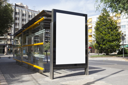 Blank billboard for advertisement, in a bus stop at the street Banco de Imagens