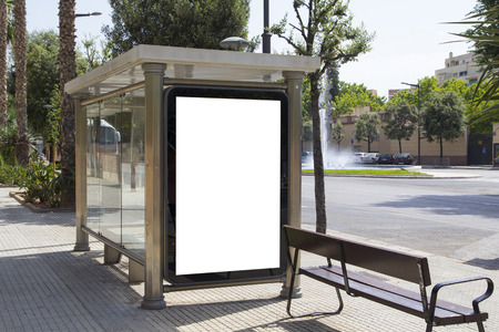 white poster: Blank billboard for advertisement, in a bus stop at the street Stock Photo
