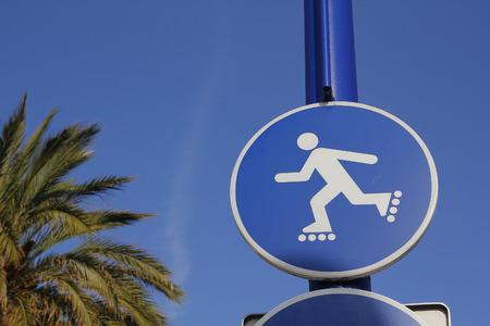 rollerblade: Rollerblade blue sign, in a public park