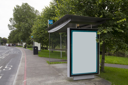 shelter: Blank billboard in a bus stop, urban landscape Stock Photo