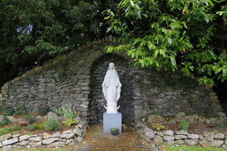 Mother Mary: Statue of virgin Mary, in a stone altar Stock Photo