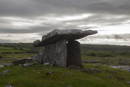 history architecture: Poulnabrone dolmen in the Burren, County Clare, Ireland. Dating back to the Neolithic period Stock Photo