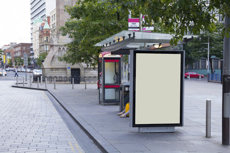 shelter: Blank billboard in a bus stop, in urban environment Stock Photo