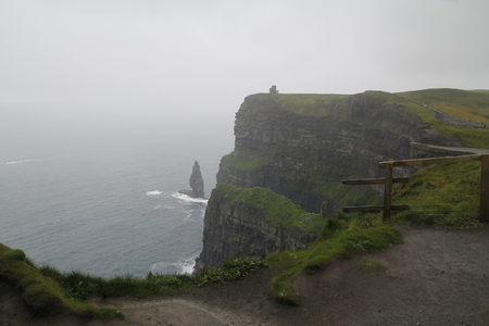 moher: Cliffs of moher in Ireland, in a cloudy day Stock Photo