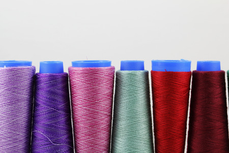 Colorful sewing coils isolated on white background