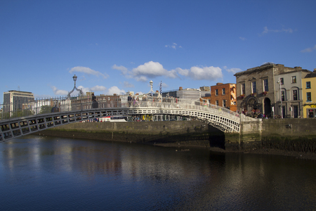 liffey: DUBLIN, IRELAND - AUGUST 03, 2015: City view of Dublin, capital of Ireland, with Hapenny bridge over the river Liffey on august 03, 2015