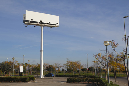 advertising signs: Blank billboard for advertising, in a car park Stock Photo