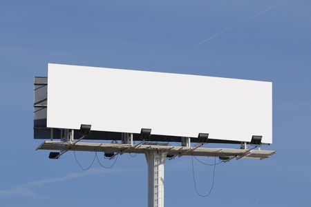 Blank billboard for advertising, against blue sky Фото со стока