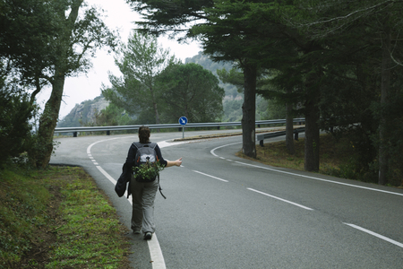 hitch: Hitch hiking woman, walking in a road in the forest