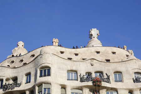 modernism: BARCELONA, SPAIN - DECEMBER 28, 2015: Casa Mila, La Pedrera from the catalan architect Antoni Gaudi, famous architecture of Modernism style in Barcelona, on December 28, 2015