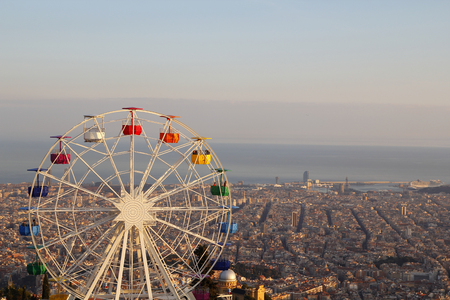 spinning: Ferris wheel on top of the city, at Tibidabo, Barcelona Stock Photo