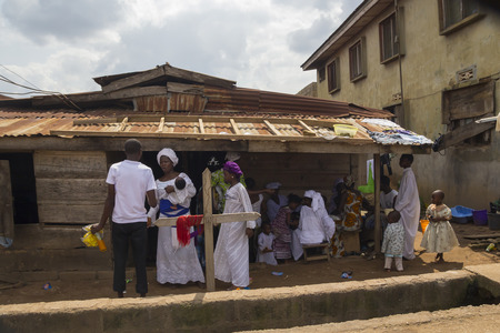 christian festival: Akure, Nigeria - August 12 2012: Some african people dressing white clothes, in a religious ceremony at the city of Akure, Nigeria, on August 12, 2012