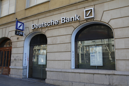 bank branch: REUS, SPAIN - February 20, 2016: Deutsche Bank branch office, with white text and logo, in the city of Reus at Spain, on februrary 20, 2016