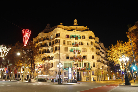 modernism: BARCELONA, SPAIN - DECEMBER 28, 2015: Casa Mila, La Pedrera from the catalan architect Antoni Gaudi, at night. Famous architecture of Modernism style in Barcelona, on December 28, 2015