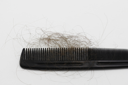 black person: Comb with hair loss isolated in a white background