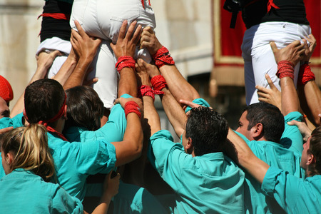 traditional climbing: TARRAGONA - SPAIN. SEPTEMBER 19, 2010 - People making human towers, a traditional spectacle in Catalonia called castellers, with people climbing and making high structures in the city of Tarragona, on September 19, 2010 Editorial