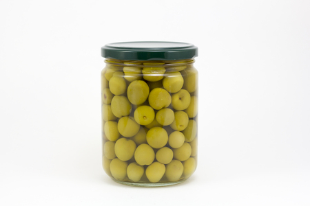 vegetable tin: Canned olives in a glass jar, isolated in a white background Stock Photo