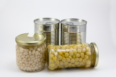 Canned food, beans and chickpeas isolated in a white background