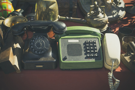 old desk: Old telephones in a jumble sale