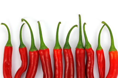 Red chili peppers, isolated in a white background