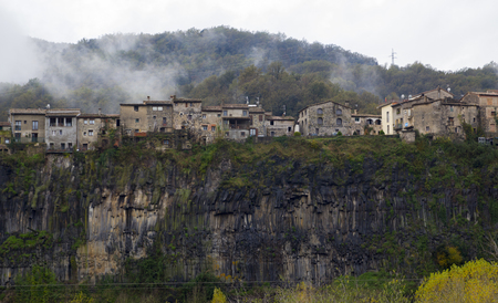overwhelming: Castellfollit de la Roca is a village of Garrotxa, in the province of Girona, Catalonia, Spain. The urban area is bordered by the confluence of the Fluvi� and Toronell rivers, between which the towns basalt cliff rises.
