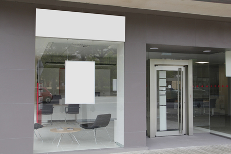 Office with blank showcase, with hanging billboard Imagens