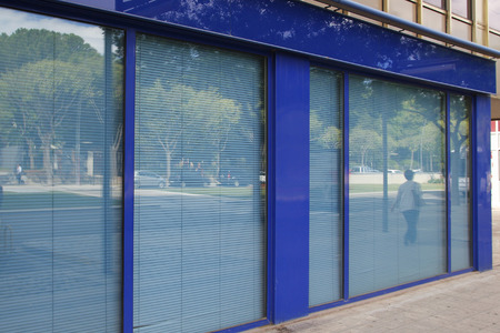Closed office in the street, in blue tones Standard-Bild