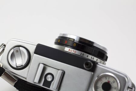 analogical: Old analog photo camera, isolated in a white background