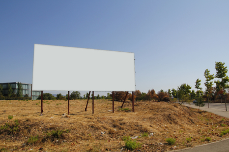 plot: Blank billboard in a plot for sale, development