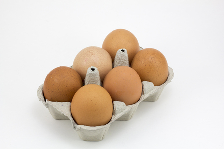 Six hen eggs, isolated in a white background