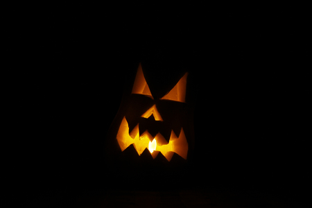 hallowen: Scary hallowen face carved in a pumpkin, with a light inside