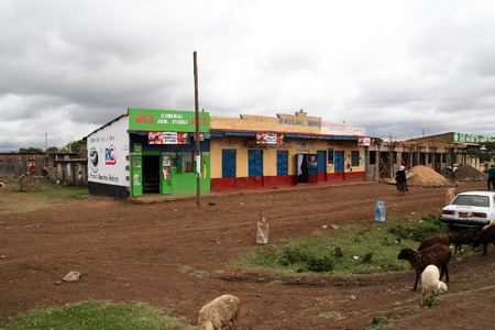 NAIROBI, KENYA - June 08, 2009: Street view of a poor suburb in Nairobi, with colorful local stores selling different things
