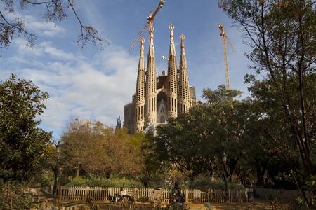 lia: BARCELONA, SPAIN - JANUARY 09, 2016: The Sagrada Família temple, designed by Catalan architect Antoni Gaudí, a large Roman Catholic church in Barcelona, Catalonia, Spain