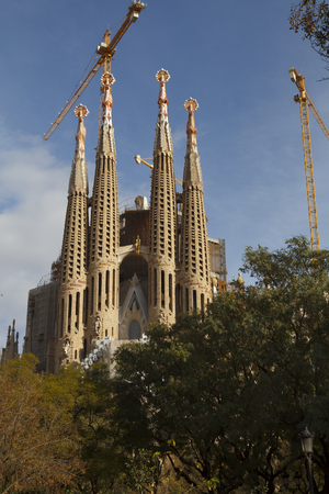 family church: BARCELONA, SPAIN - JANUARY 09, 2016: The Sagrada Família temple, designed by Catalan architect Antoni Gaudí, a large Roman Catholic church in Barcelona, Catalonia, Spain