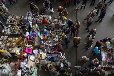 els: BARCELONA, SPAIN - JANUARY 09, 2016: Crowded flea market in Barcelona, Spain, called Mercat dels Encants. The Fira de Bellcaire is an old market for second hand goods, also known as Encants Vells Editorial