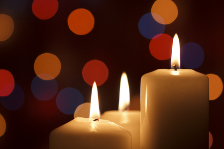 Christmas candles, with bokeh spot lights in the background