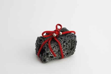 Christmas coal with red ribbon, sweet gift for naughty boys Stock Photo
