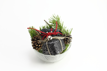 Christmas coal and pine tree leaves, sweet gift for naughty boys Stock Photo