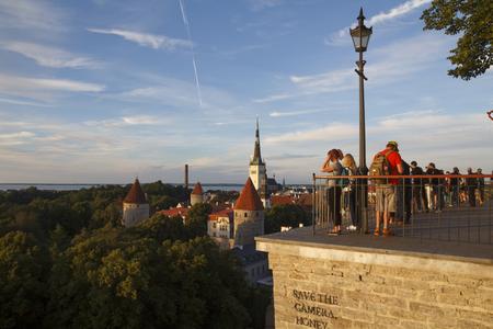 gazer: TALLINN, ESTONIA - JULY 29, 2016: People in Toompea lookout, looking to the old city of Tallinn, capital of Estonia