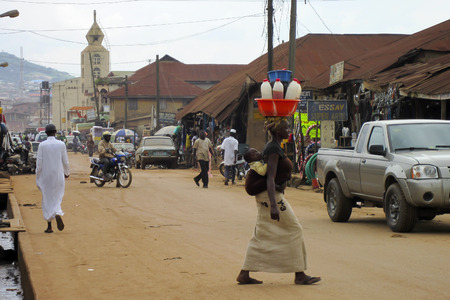 LAGOS, NIGERIA - AUGUST 13, 2012: Street view with people and cars in the city of Lagos, the largest city in Nigeria and the African continent.