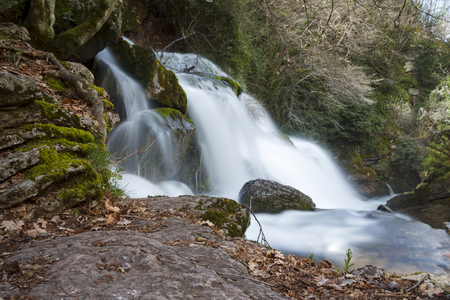 Waterfall in a river source, water flowing with power