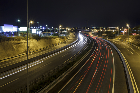Long exposure shot of highway at night, with cars driving in the road Stock Photo