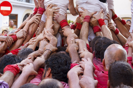 Union of people making human towers, castellers in Catalonia