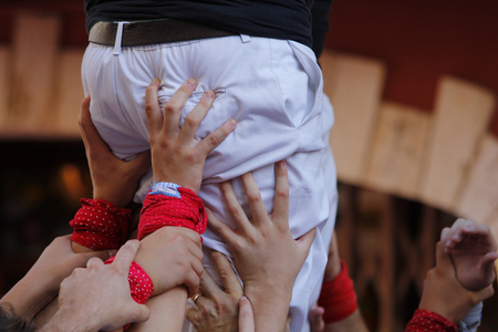 People making human towers, a traditional spectacle in Catalonia called castellers