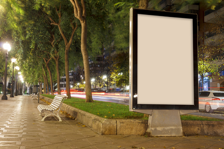 Blank advertisement mock up, in a public park at night