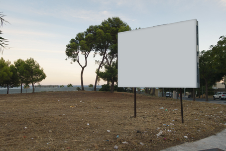 Blank billboard mock up in an urban terrain for sale, development