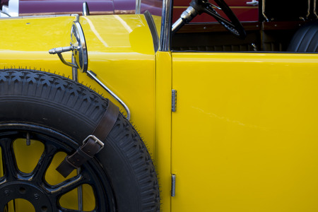 Old classic car detail, in yellow color