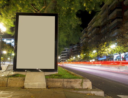 Blank advertisement mock up, with blurred traffic lights at night