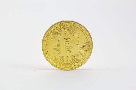 Golden bitcoin isolated in a white background Banque d'images