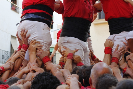 TORREDEMBARRA - SPAIN. JULY 6, 2017 - People making human towers, a traditional spectacle in Catalonia called Redakční